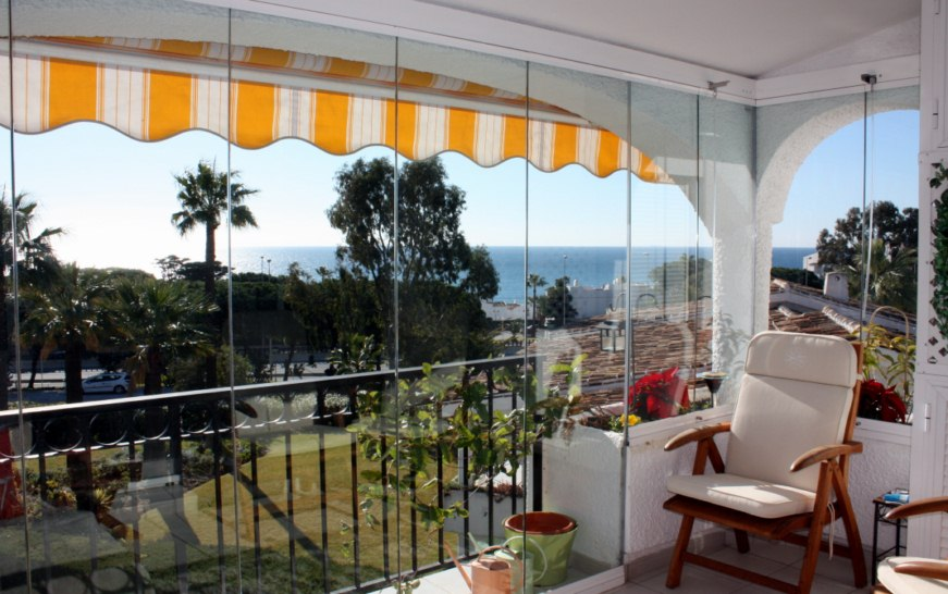 Cortinas de cristal cerramientos panor micos cierres for Cortinas para terrazas acristaladas